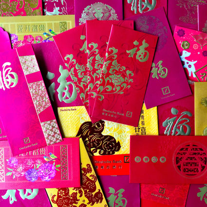 Red packets, hongbao, lai see or and pow - red envelopes packed with cash...